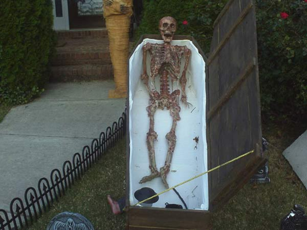 Halloween Corpse in wooden Coffin
