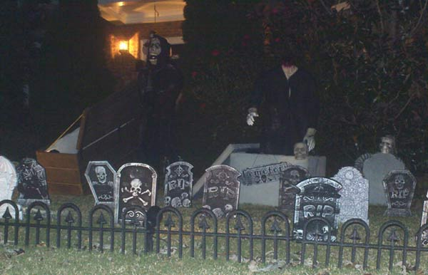 Night View of Halloween GraveYard Ghoul and Ghoul Rising from Crypt